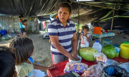 A woman in Pedernales, one of the worst-hit towns. Villages nearby remain without basic aid such as food, water and medicine.