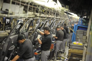 Nissan technicians preparing doors for the Qashqai car at the company's plant in Sunderland.