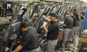 Nissan workers prepare doors for the Qashqai car in Sunderland.