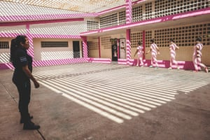 A warm-up session before playing volleyball. The program for the female detainees includes classes, sport, motivational and disciplinary workshops, art and crafts. The prison sentence is intended for reform and to avoid recidivism. Credits for good behaviour can lead to early release. State prison, Maracaibo, Venezuela, December 2018.