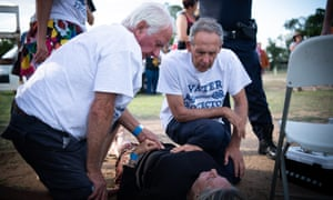 Former Greens leader Bob Brown (right) with a northern New South Wales woman who was injured during a Stop Adani Convoy event in Clermont, central Queensland.