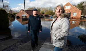 Steve and Geraldine Lister outside their flooded home on George Street in Snaith