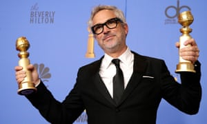 Alfonso Cuarón with his two Golden Globes.