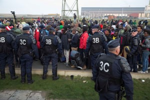 Refugees who are staying in France queue before daylight where authorities are processing them before sending them to different parts of France.