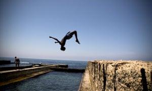 Children play along the Mediterranean coast of Tripoli.