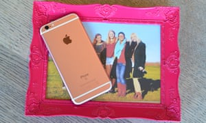 iphone 6S on a pink photo frame.