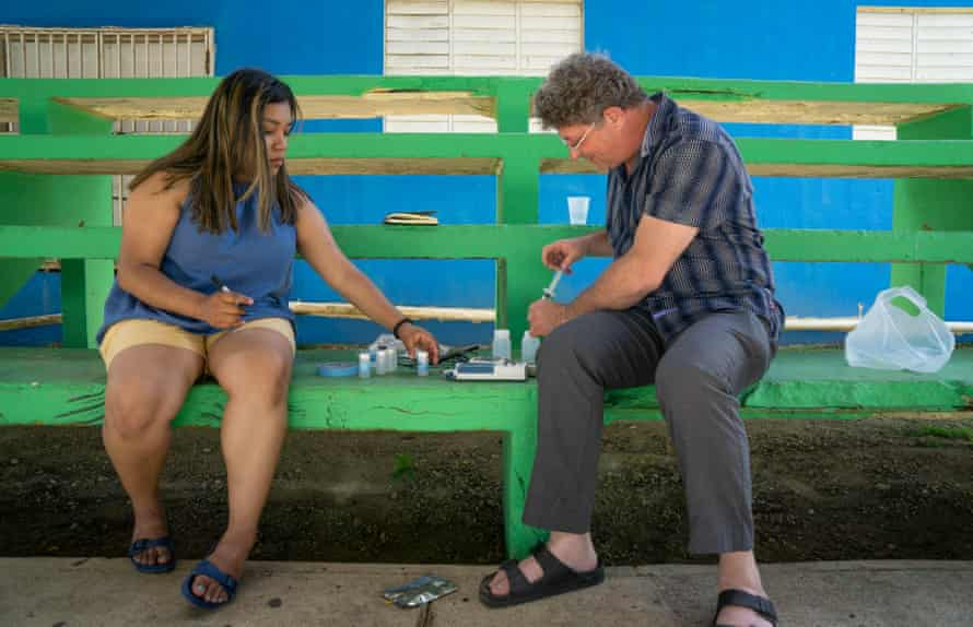 Benjamin C Bostick, PhD, from Columbia University, and CUNY intern Alondra Cruz Portillo test water collected in the northern town of Arecibo, Puerto Rico.
