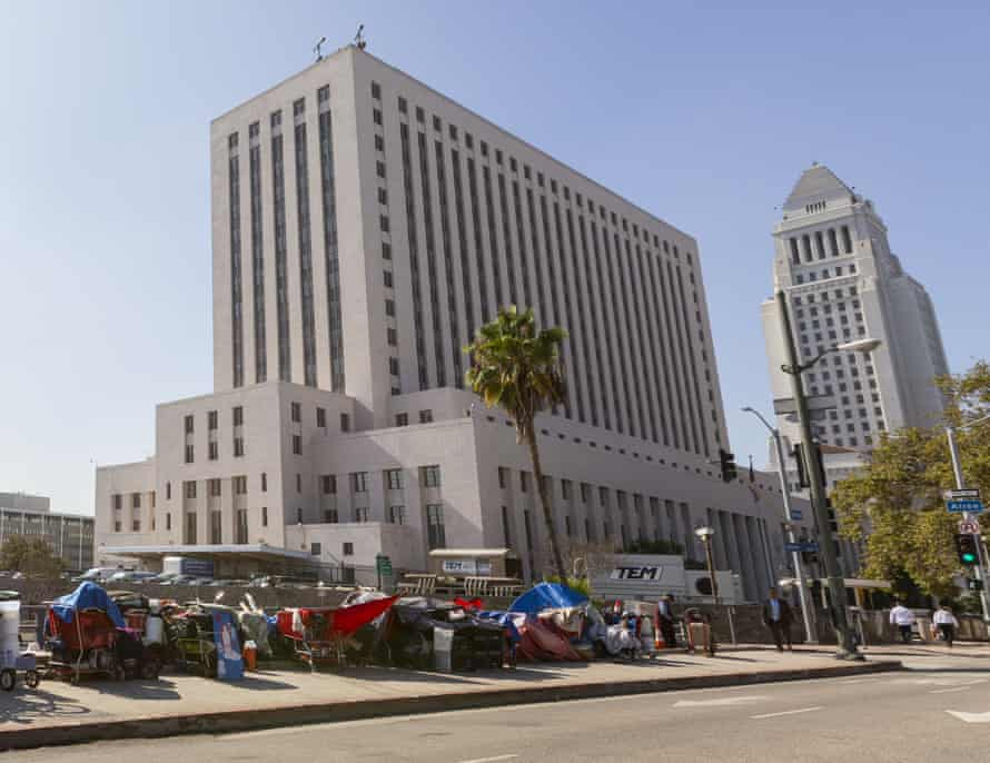 A homeless encampment lies in the shadow of the courthouse in downtown Los Angeles.