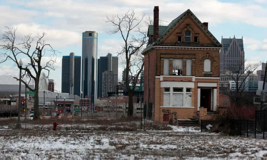 A boarded-up house in Detroit is seen in front of the city's downtown.