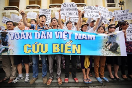 Protesters in Hanoi hold a banner saying 'Vietnam people, save the sea' at a rally against the government's response to the toxic spill from the Formosa Ha Tinh steel plant.