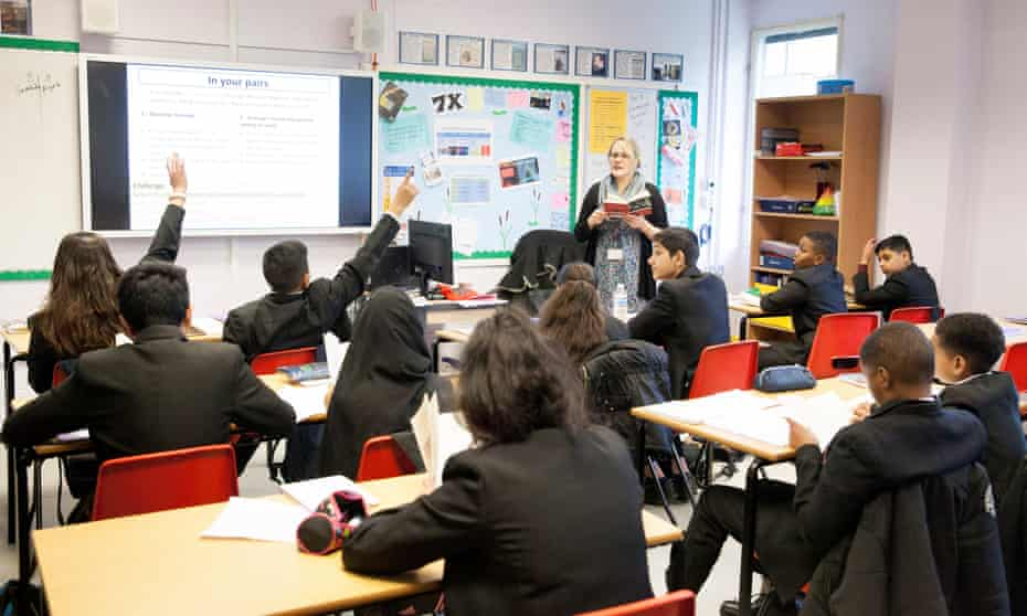 Year 8 pupils in a classroom at Cranford community college in Heston, west London