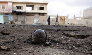 An unexploded cluster bomblet is seen after airstrikes by pro-Syrian government forces in the rebel-held al-Ghariyah town, in Deraa province.