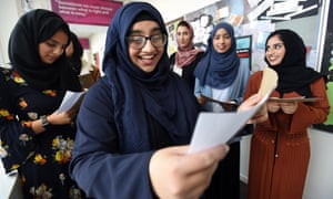 Aasia Majid reacts with delight at her A-level results at Tauheedul Islam girls' high school in Blackburn.