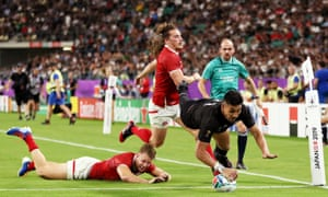 Rieko Ioane of New Zealand grounds the ball to score his side's fifth try.