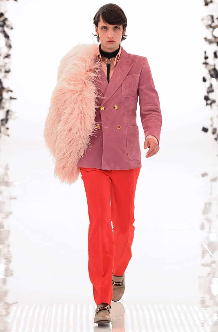 male model in pink jacket and orange pants