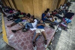 Honduran migrants taking part in a caravan heading to the US, rests during a stop in Mapastepec, Chiapas state, Mexico