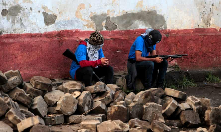 Supporters of President Ortega sit in a barricade after clashes with demonstrators in Monimbó, Masaya.