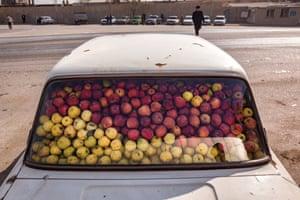 "Baku, Azerbaijan. Longitude: 49¡ 83' 53.41"" A car filled with apples"