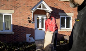 Neil Bridgeman outside his new home on Persimmon's development at George Ward Gardens in Wiltshire
