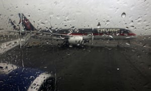 Trump's plane is pictured though the rain-covered window of the press charter plane on the tarmac of LaGuardia airport in New York on Thursday.