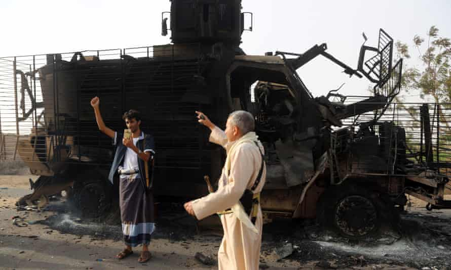 Yemenis check the wreckage of an armoured vehicle after clashes between Saudi-led coalition and Houthi forces near the coastal town of Hodeidah on Tuesday.