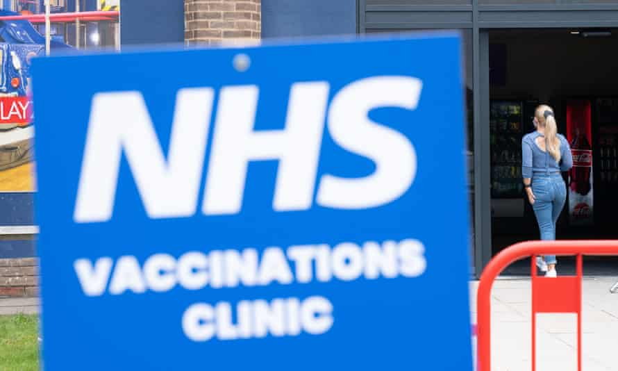 A person enters an NHS vaccination clinic