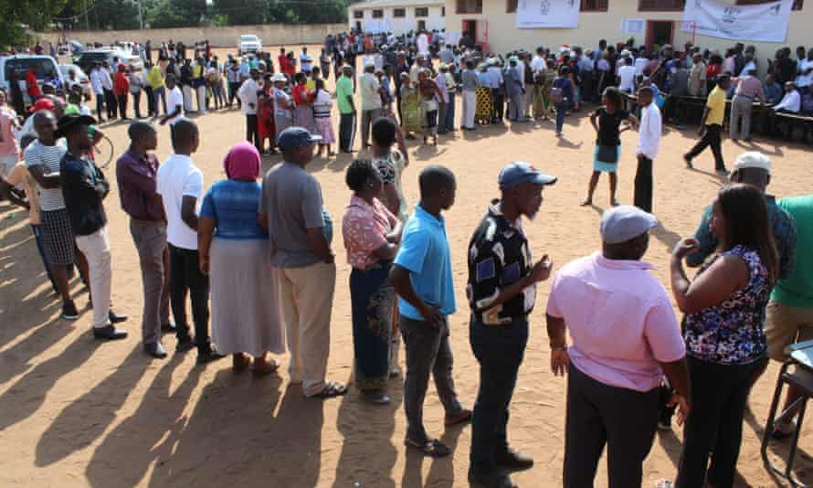 People queue to cast their votes in Matola, Mozambique