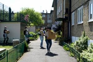 Volunteers deliver food parcels for vulnerable residents of Hackney, east London.