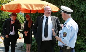 a man in a suit talks to a policeman