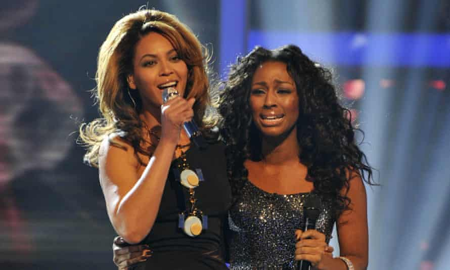 Aelxandra Burke with Beyoncé on The X Factor in December 2008