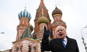 Boris Johnson stands in front of St Basil's Cathedral during a visit to Red Square, in Moscow, Russia December 22, 2017