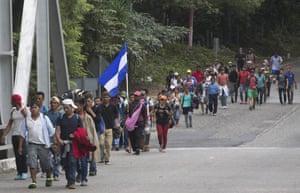 Honduran migrants walk toward the U.S. as they make their way through Chiquimula, Guatemala