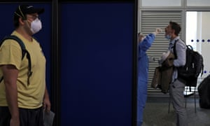 A passenger from a Lufthansa flight is tested for coronavirus at Athens airport.