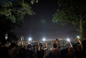 Protesters stand on top of Lion Rock in Kowloon on 23 August 2019. Thousands of protesters held hands and lit their phones, replicating the famous pro-democracy Baltic Way protest across Latvia, Estonia and Lithuania in 1989