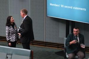 Gladys Liu talks to LNP Bert van Manen before question time.