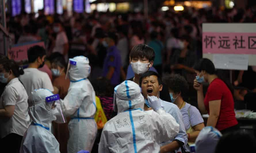 A man is tested for coronavirus in the Liwan district in Guangzhou.