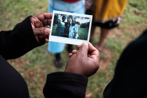 "Minky's friend Jabu Shongwe, 52, holds an instant photo of herself with her friends Nelile Dlamini, 37 (left), and Sibusile Nkambule, 42 (right), which was taken at Shongwe's home in New Thulwane. ""I don't have words to describe Minky, she is something else, I can't describe her. She is everything!"" says Jabu. ""We are all the same. Everyone is crazy! When we meet up, it's hard for us to go back home because we are always telling jokes!"" Since this photograph was taken, Nelile Dlamini has passed away"