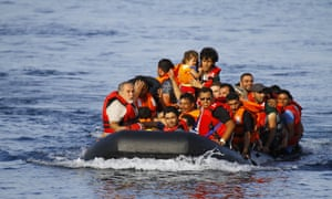 A dinghy full of people approaches the coast of Lesbos