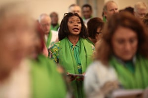 A woman sings in St Helen's church. Wellwishers were invited to wear green for Grenfell