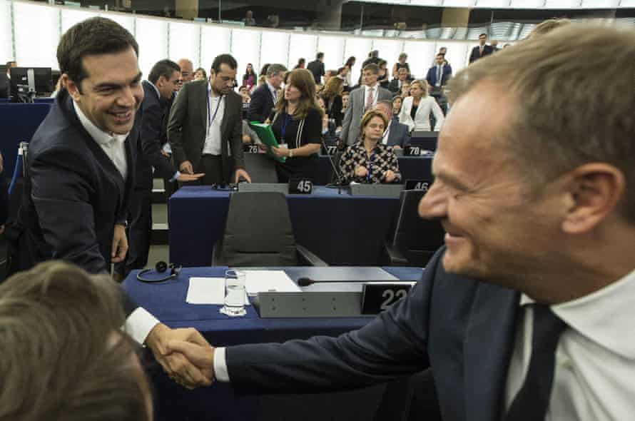 Greek prime minister Alexis Tsipras, left, shakes hands with Donald Tusk.