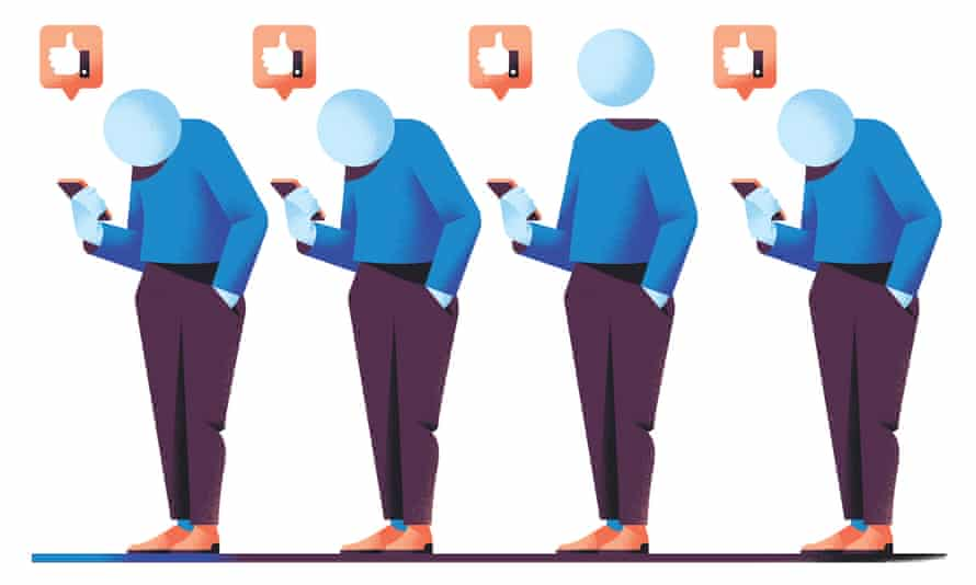 Four figures looking at mobile phone