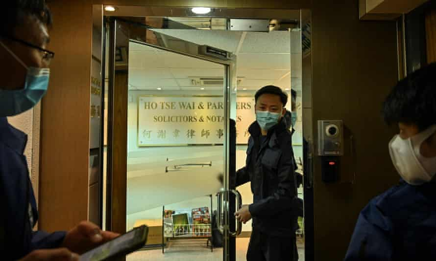 Police are seen inside the office of former pro-democracy lawmaker and lawyer Albert Ho after more than 50 Hong Kong opposition figures were arrested.