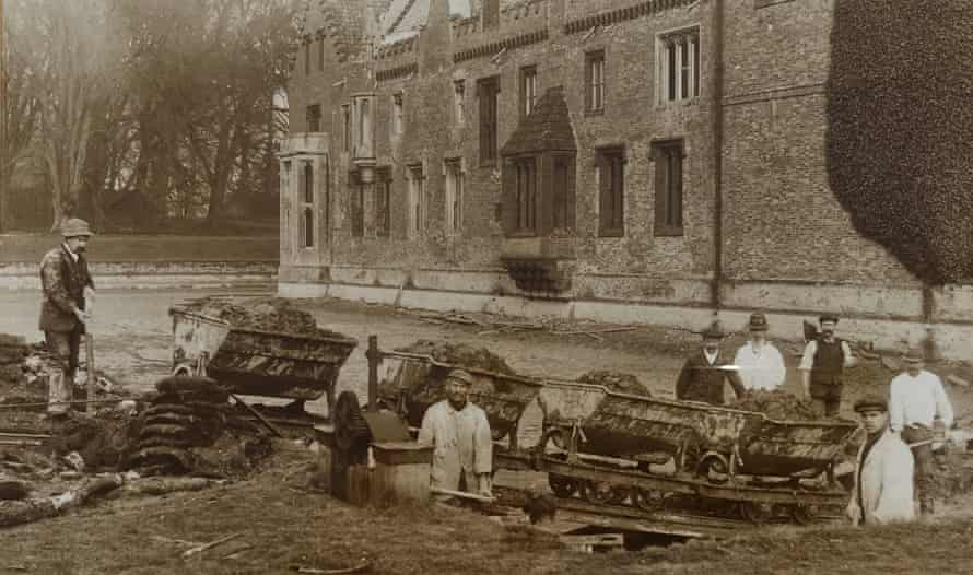Workers dig out a moat at Oxburgh Hall in Norfolk, England, 1900-1910.