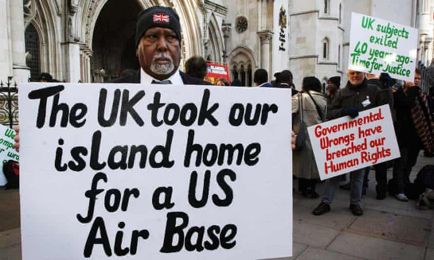 Chagos Islanders protest outside the High Court, London.