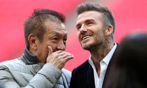 Salford City co-owners David Beckham and Peter Lim celebrate after the match