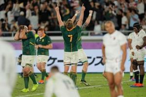 Maro Itoje reacts as Pieter-Steph du Toit celebrates at full-time.