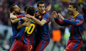Sergio Busquets celebrates the culmination of Pep Guardiola's vision as Manchester United were put to the sword in the 2011 Champions League final at Wembley.