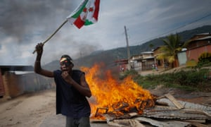 A protester waves a Burundian flag during an anti-government demonstration in Bujumbura.
