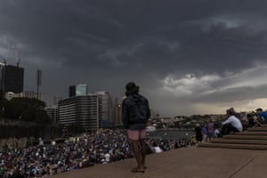 Heavy storms sweep across Sydney on New Year's Eve on Sydney Harbour