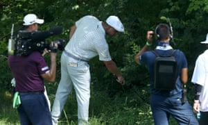 Bryson DeChambeau looks for his tee shot on the 15th at Muirfield Village where he eventually racked-up a tournament-ending quintuple-bogey 10 on Friday